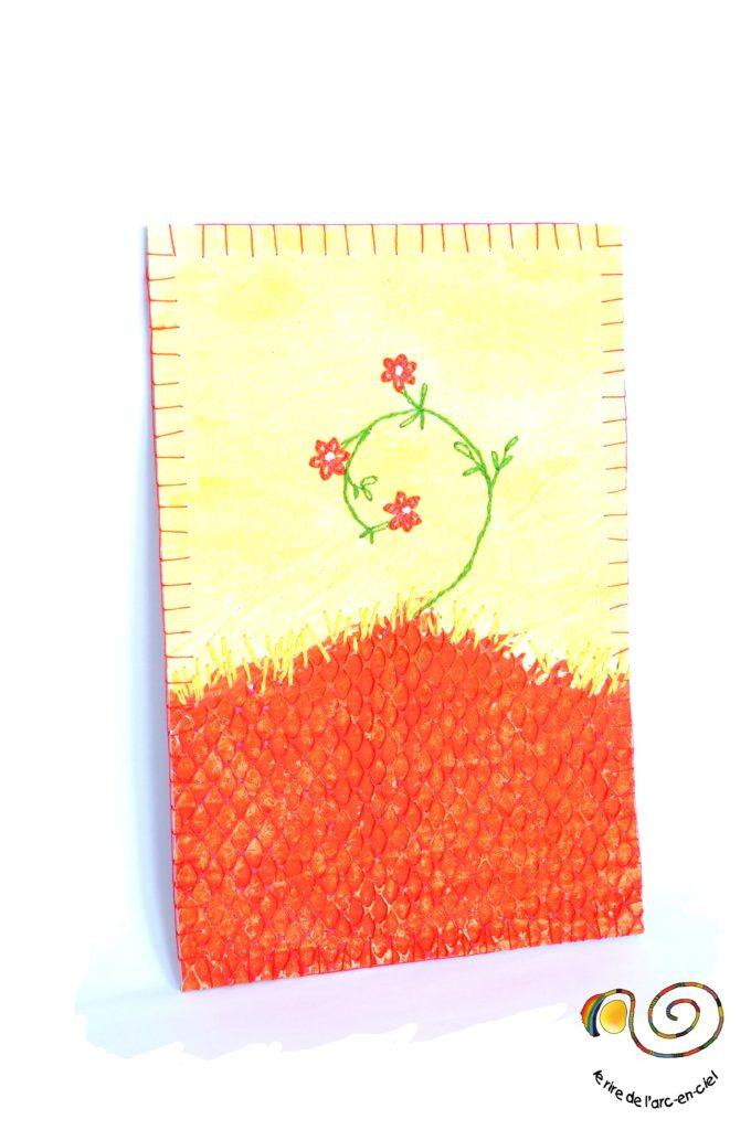 Carte  réalisée en technique mixte, rouge et jaune