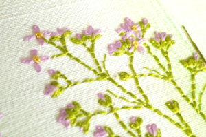 Détail de tableau brodé, fleur